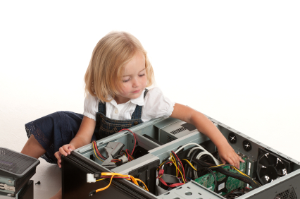Child fixing or destroying  a computer.
